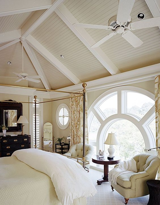 arched window bedroom floor to ceiling