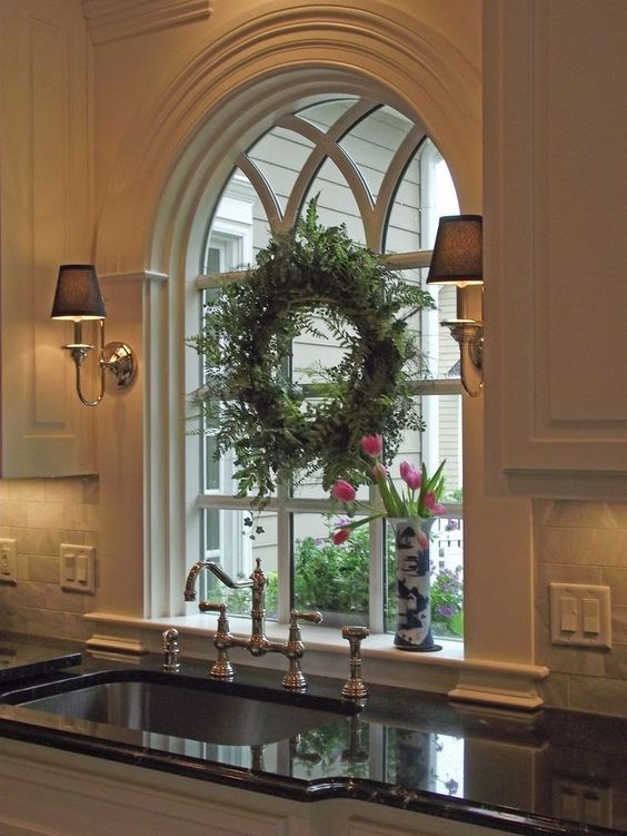 beautiful arched window over kitchen sink