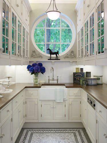round window over kitchen sink