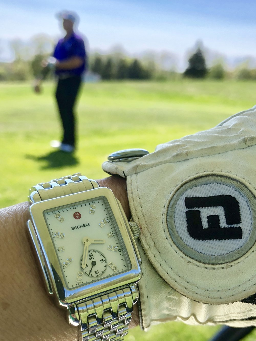 Out golfing with the M.r at mingo loop in rangeley, Maine. My michele watch is telling me it's time to head into town for dinner and a cocktail.