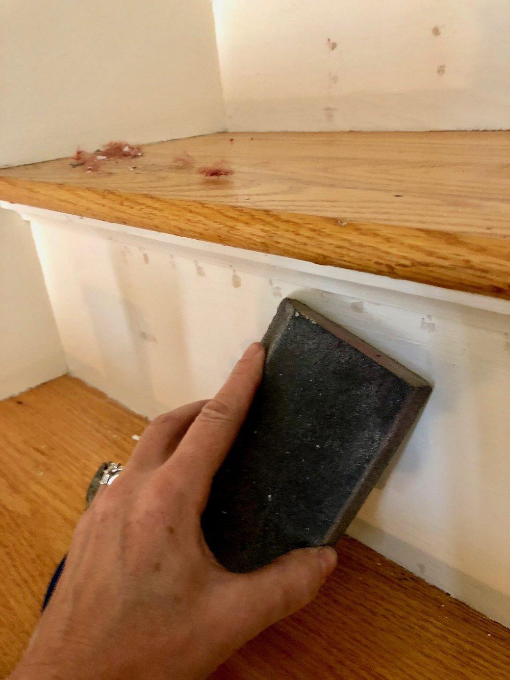 sanding carpet tack holes on stairs.jpg