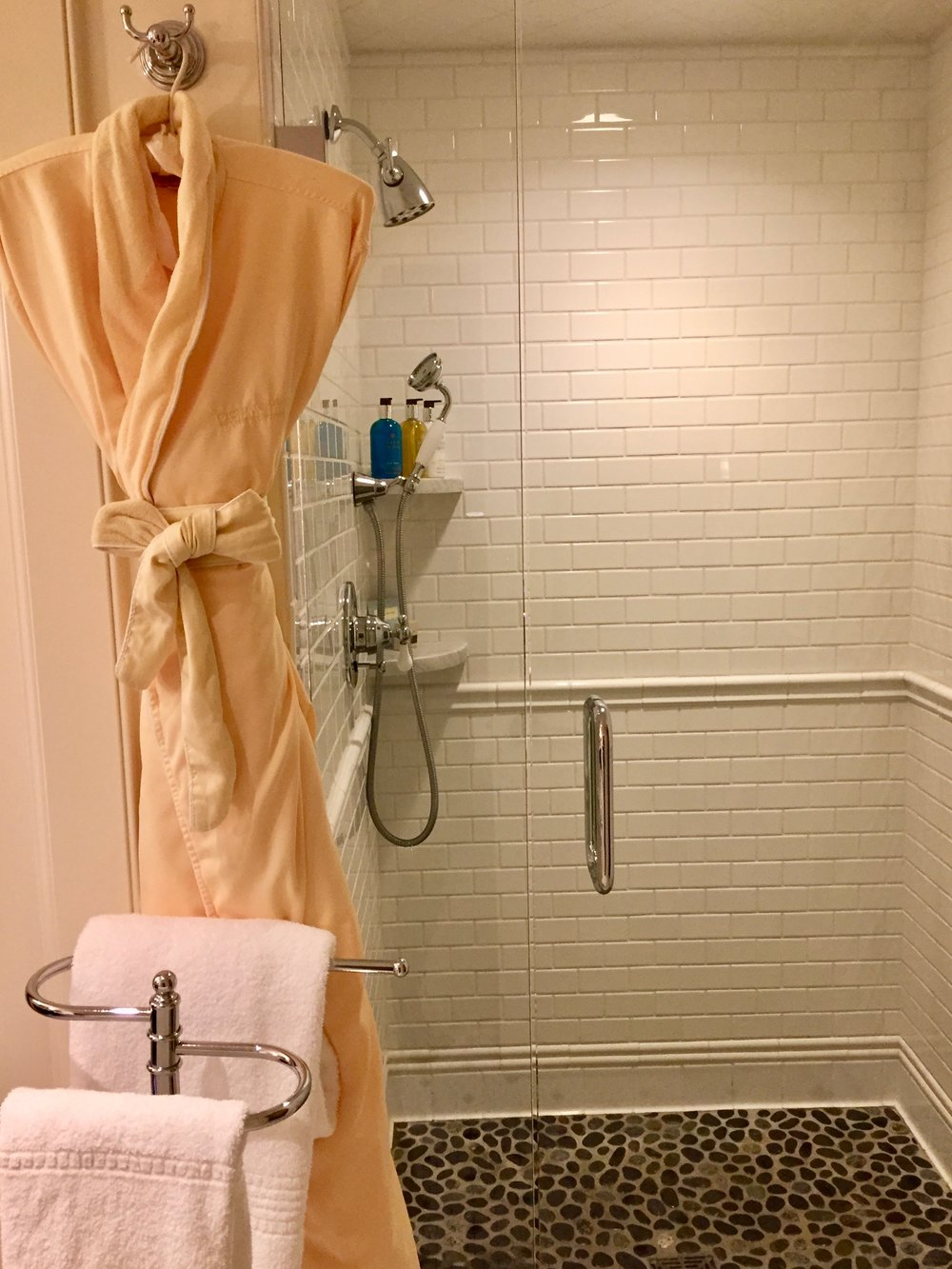 plush hotel bathrobe luxury shower