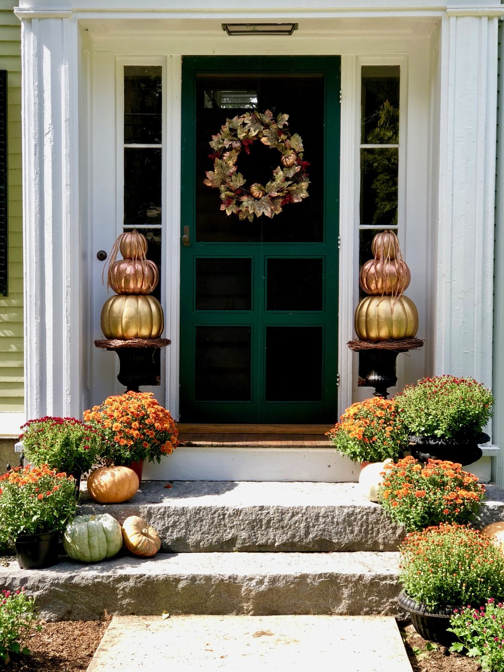 New England fall entrance with pumpkin topiaries new england fine living.jpg