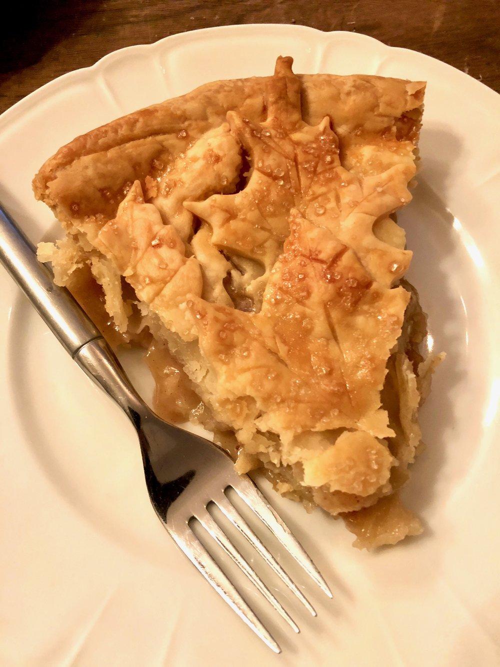 A slice of warm apple pie