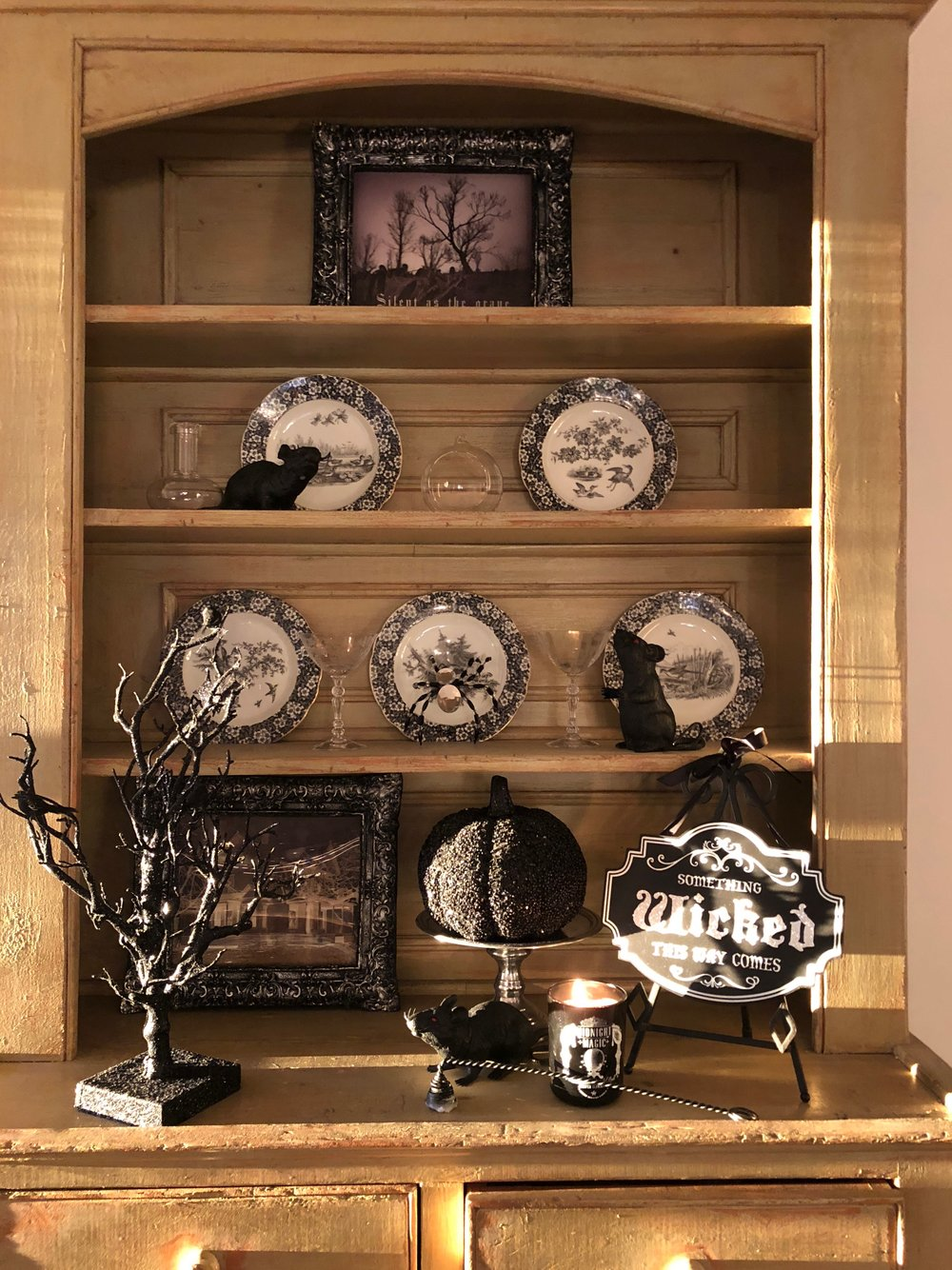 country hutch decorated for halloween black and white decorations