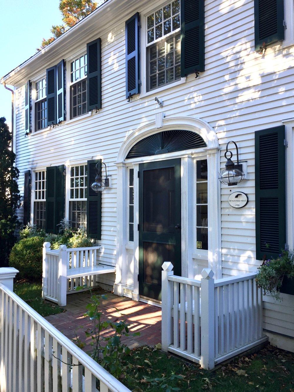 white marthas vineyard home green shutters green door onion light massachusetts new england.jpg