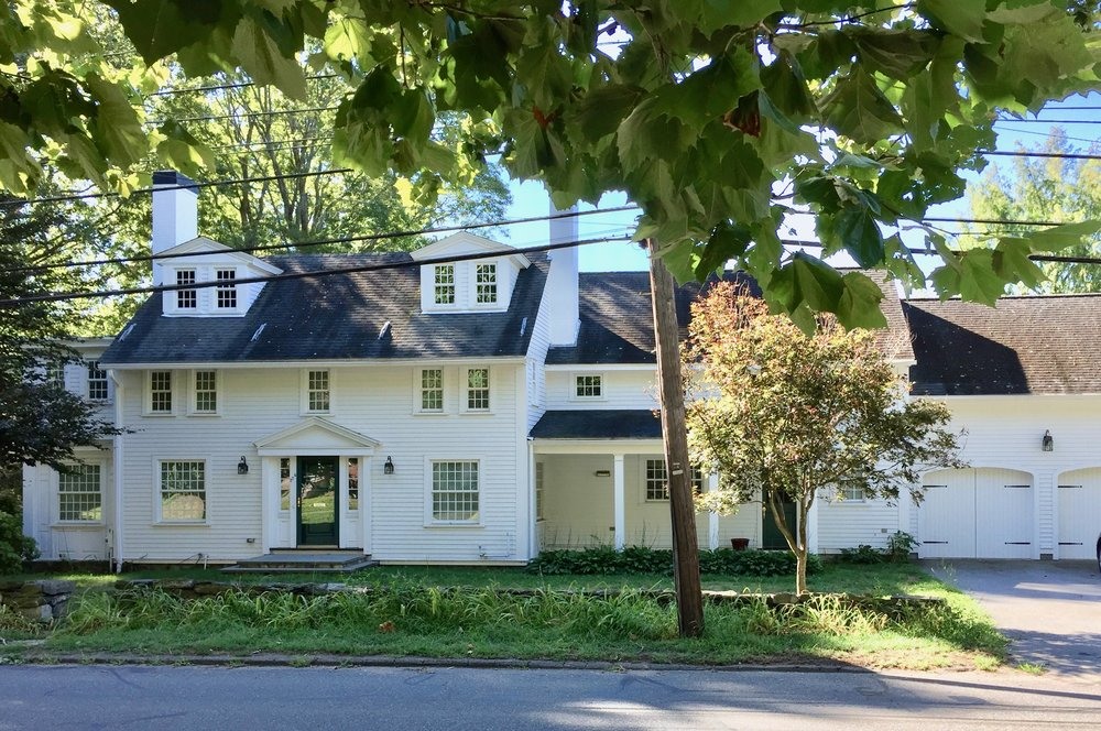 antique colonial white home with white chimney with black top concord MA historic town New England home.jpg