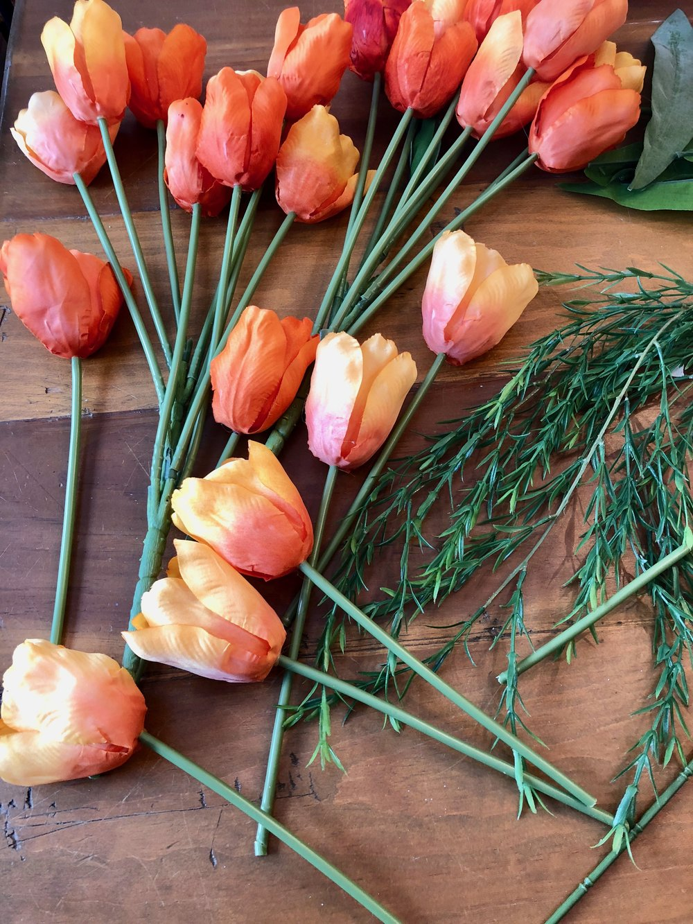 making a carrot out of orange tulips for Easter