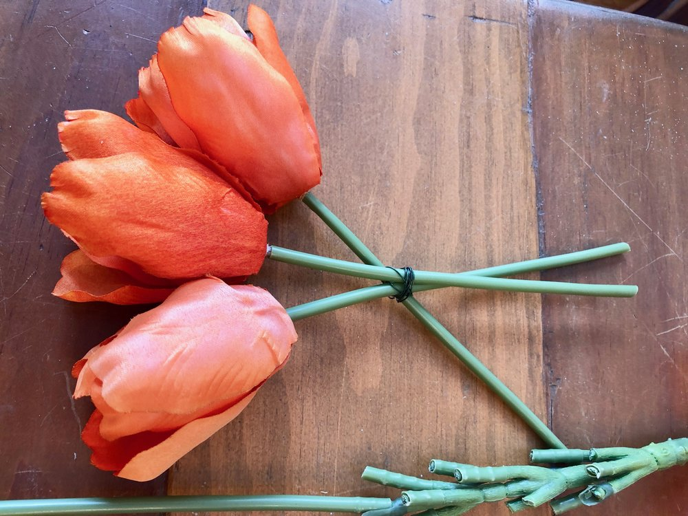 wiring together tulips to make a carrot for Easter