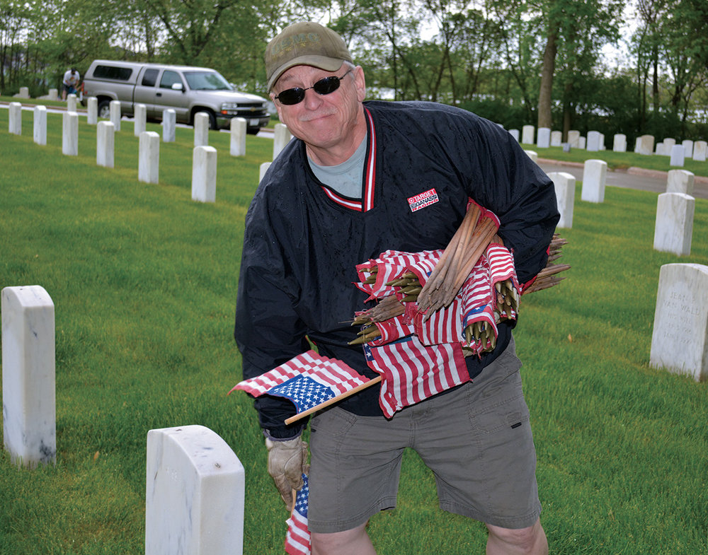In time for Memorial Day, the GE Veterans Network members honored those who made the ultimate sacrifice by planting flags on grave sites of fallen heroes at Wood National Cemetery (WNC).