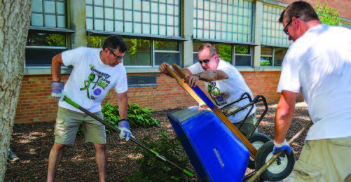 over 2,100 employees and friends converged on 22 different schools in milwaukee, waukesha, hartford, and wauwatosa with rakes, paint brushes, and hammers to help them prepare for the new school year.
