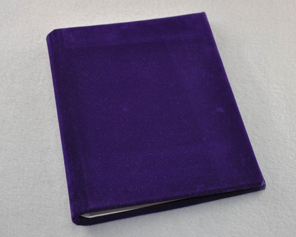 "Try our purple velvet covered 6"" x 8"" handmade journal."