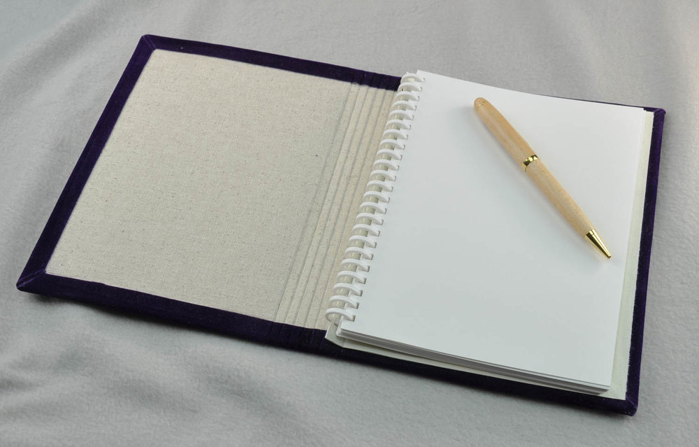 "Our 6"" x 8"" handmade journal comes with a choice of 100% recycled paper."