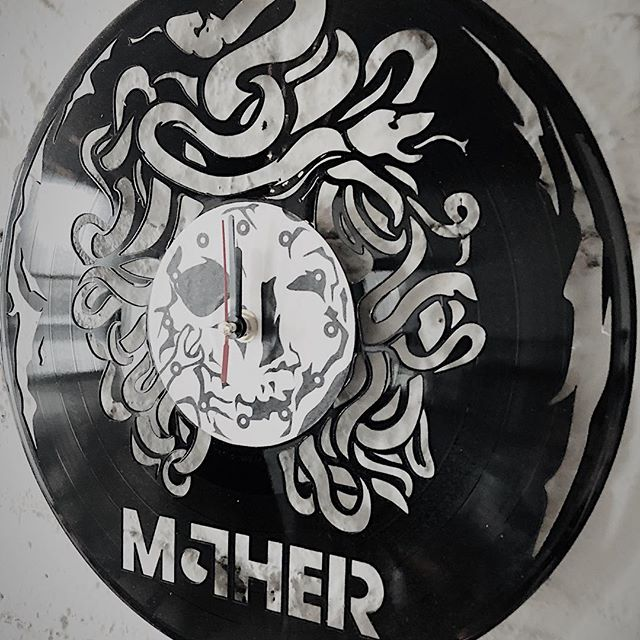 """Awesome gift from @jfargs3! Custom clock made from a 12"""" record. Looks great in the new space. . . . #rocknroll #mother #rockyourmother #custom #clock #art #vinyl #record #time #ticktock #midnight #friday #music #band #whattimeisit #gametime #gift #present"""