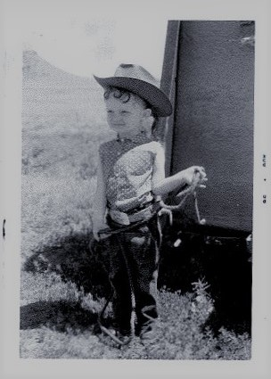 Kathy wearing her red cowgirl boots in Ekalaka, Montana 1956.