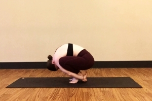 Malasana--Garland Pose helps you feel the same rounding sensation that happens in Crow and One-Legged Crow II. When you squeeze your knees toward your shoulders you'll get inner thigh activation that's essential in EPB2.