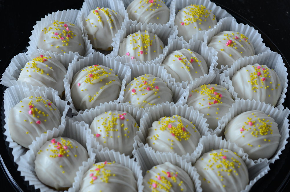 Lemon - Lemon pound cake, lemon meringue buttercream, white chocolate, lemon glaze, pink sweethearts, yellow jimmies