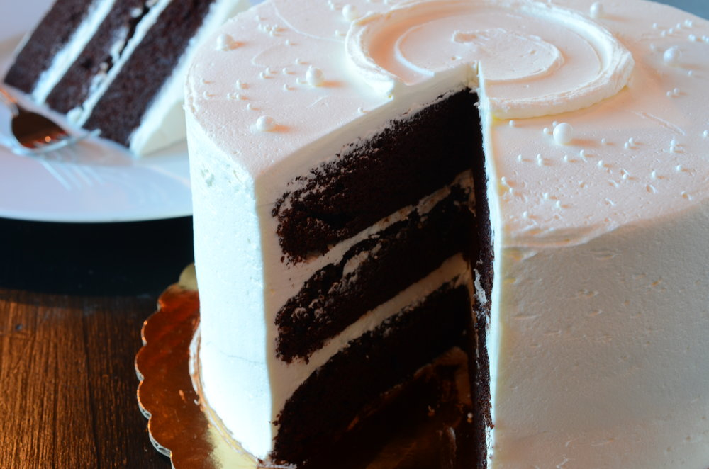 """SOUTHERN CHOCOLATE  Our owner's favorite slice! Velvety moist hot chocolate cake with a sweet dense Southern style vanilla buttercream. This one will bless your heart.  8"""" $43 / 10"""" $89"""