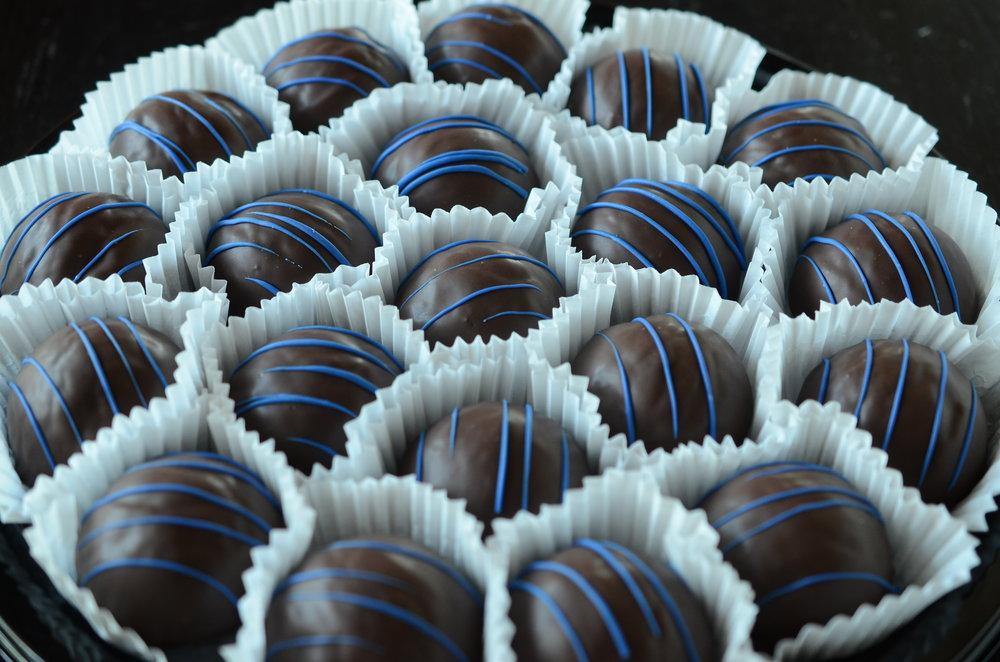 Durham Bull Balls - Chocolate cake, Belgian chocolate buttercream, dark chocolate, blue drizzle