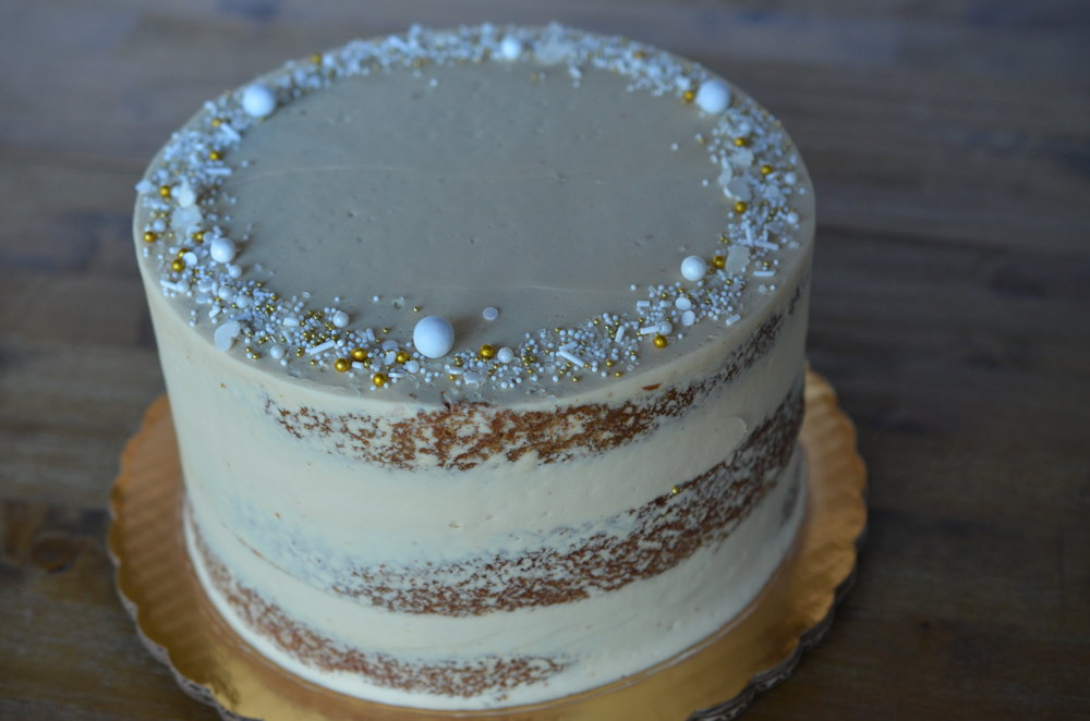 SEMI-NAKED  A rustic design using a light amount of buttercream to expose the cake layers.