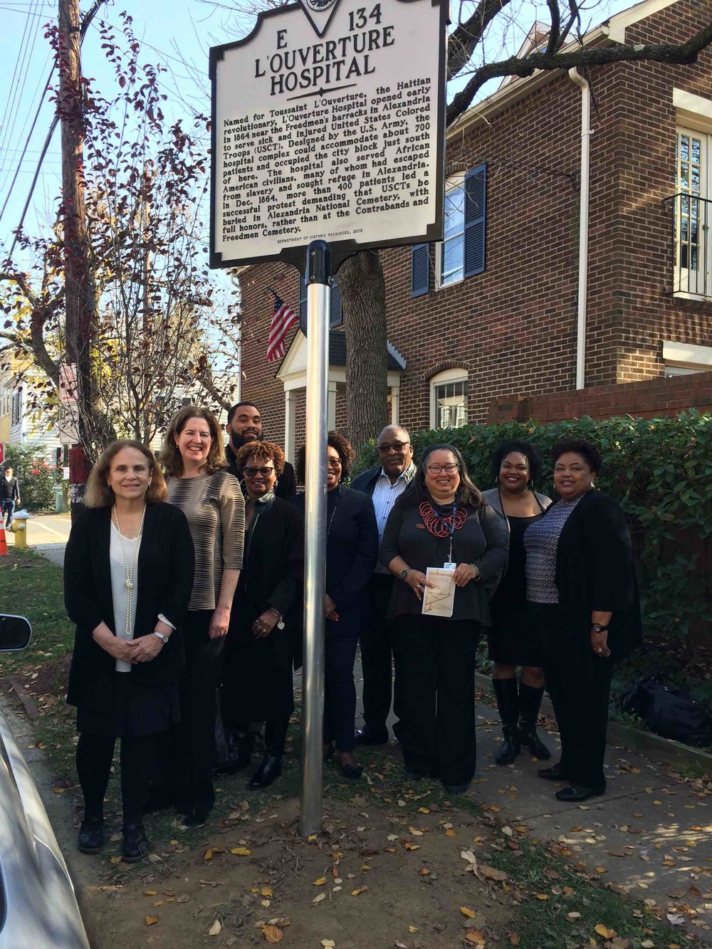New sign, with City Archaeologist Fran Bromberg, Mayor Alison Silverberg, members of the Shiloh Baptist Church Choir, and Alexandria Black History Museum Director Audrey Davis. Photo by Ruth Reeder.