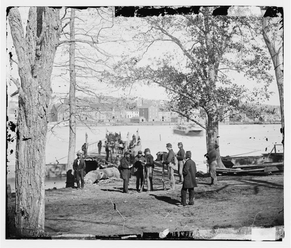 Inspecting a pass at the Mason's Island ferry landing. From Library of Congress.
