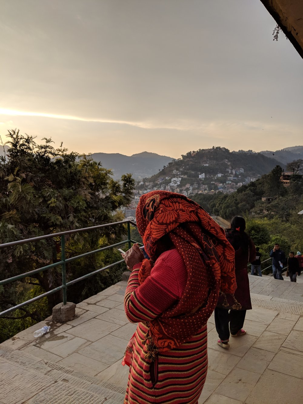 A Kathmandu resident taking in the overwhelmingly smoky sunset with a cigarette