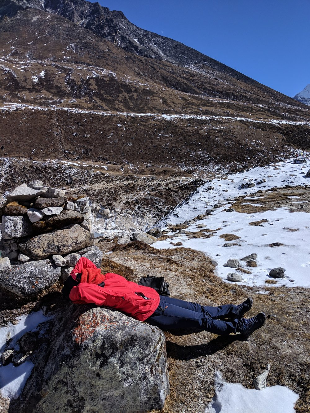 Basking in the sun atop one of the peaks- the only way to thaw!