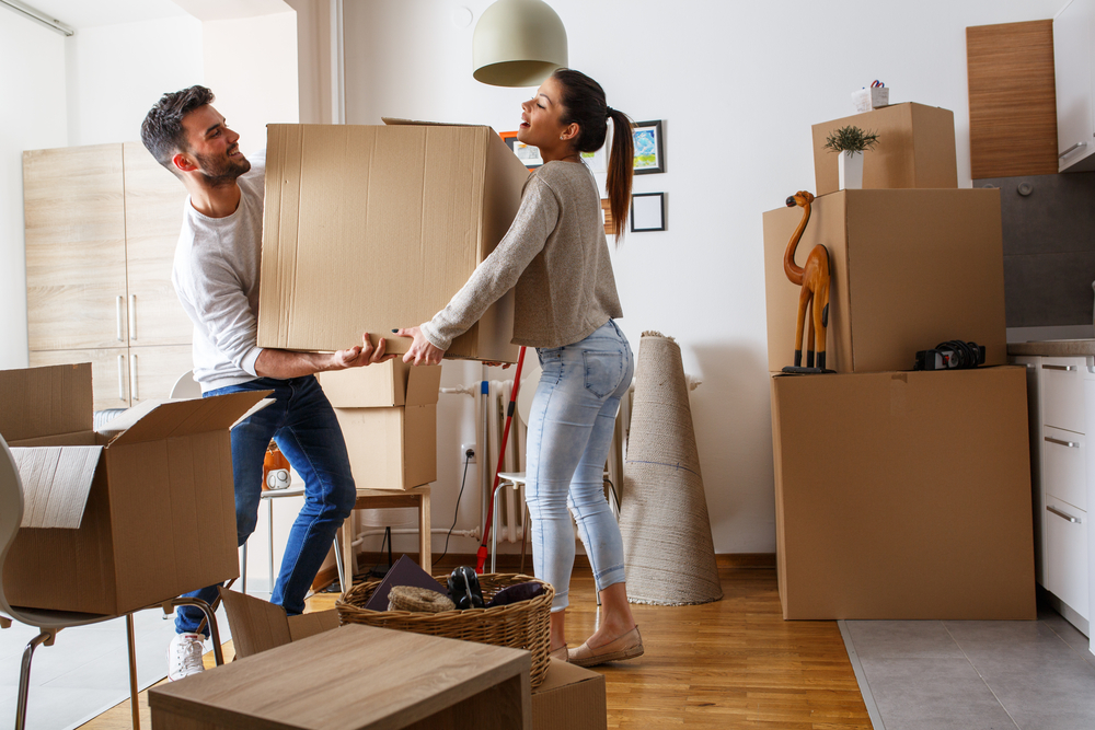 couple moving large boxes