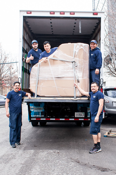 The Professional Moving Specialists finishing up a job