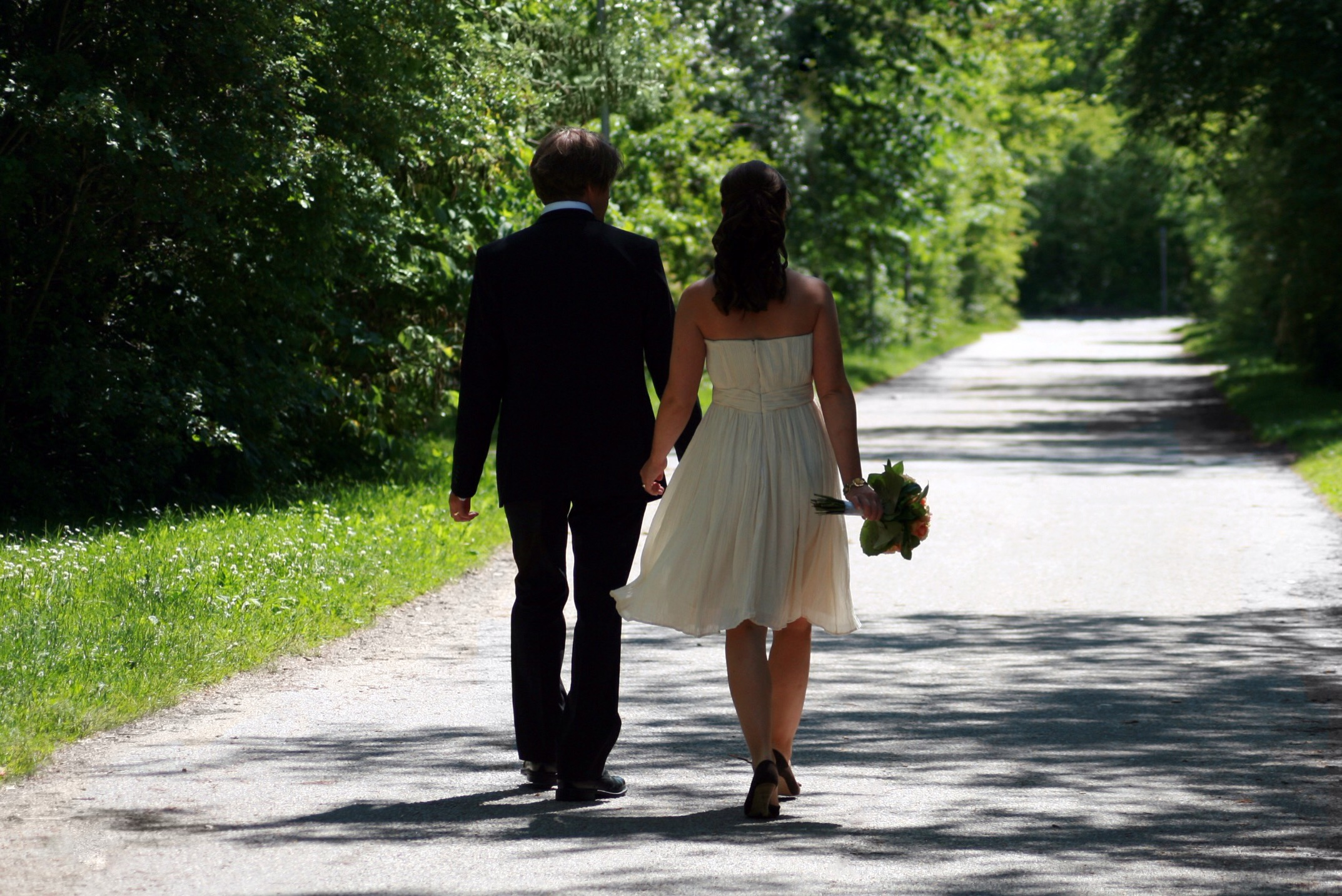 Married couple walking down country road enhanced