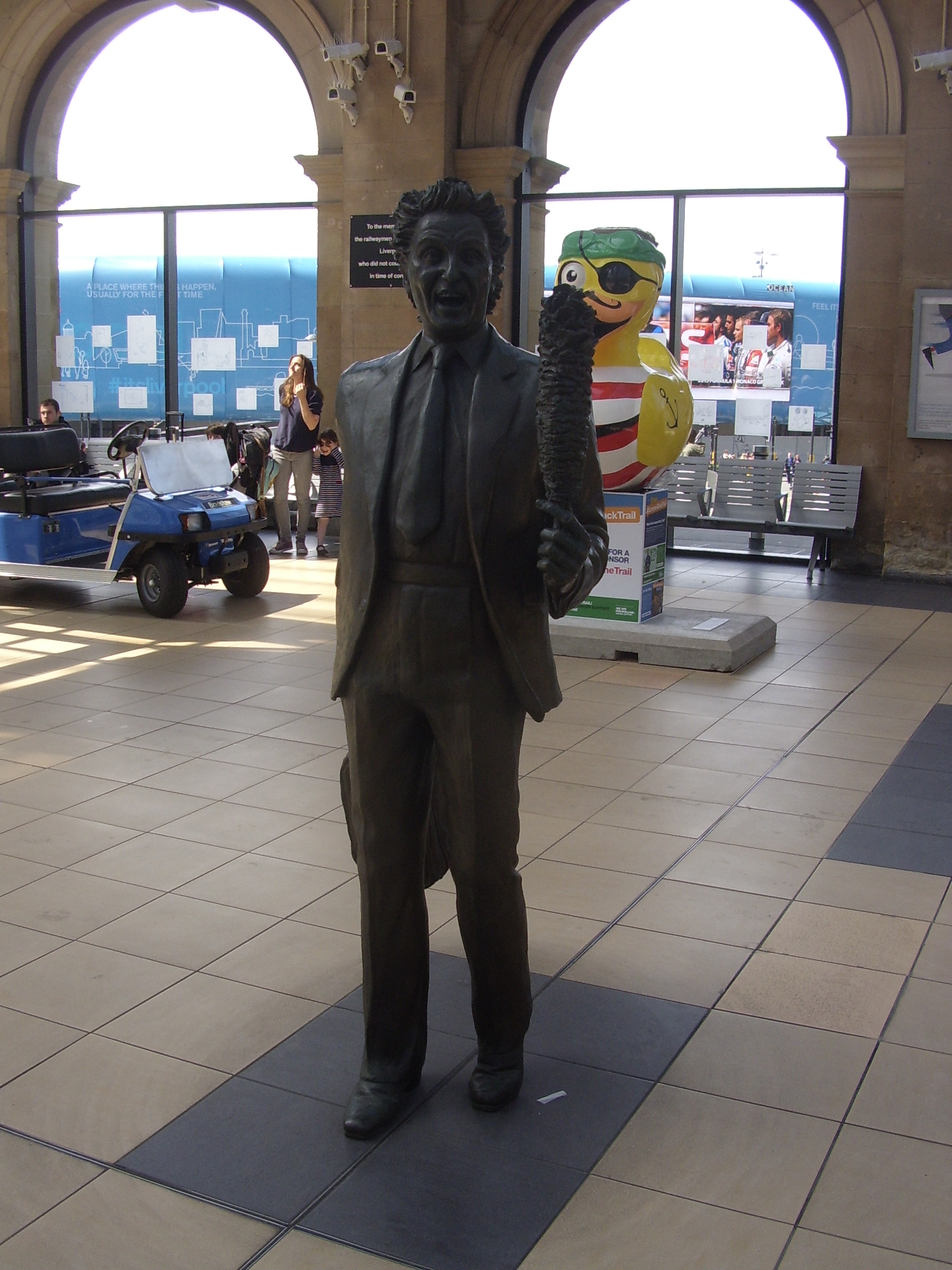 Statue of Ken Dodd in Lime Street Station Liverpool.