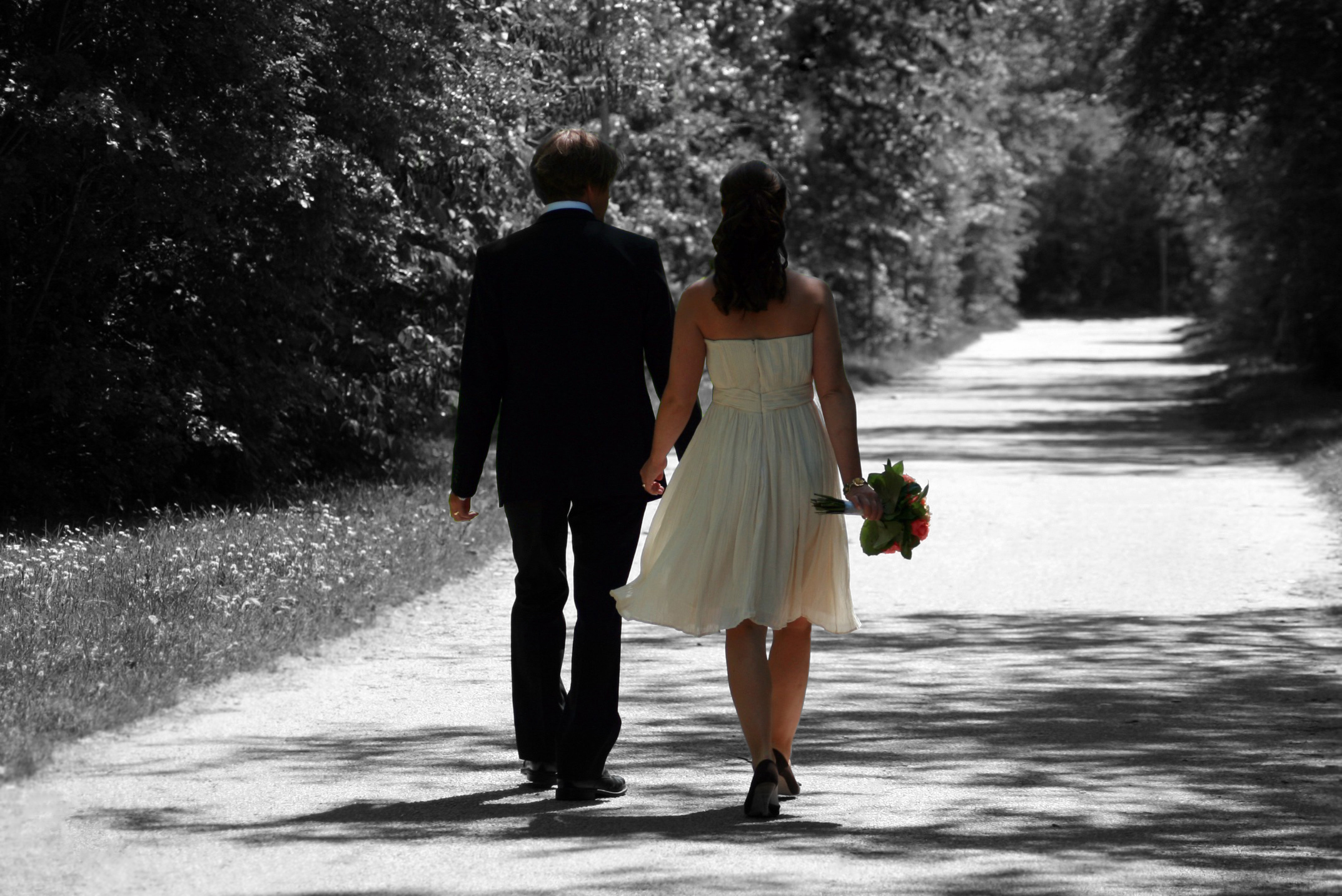Married couple walking down country road enhanced further