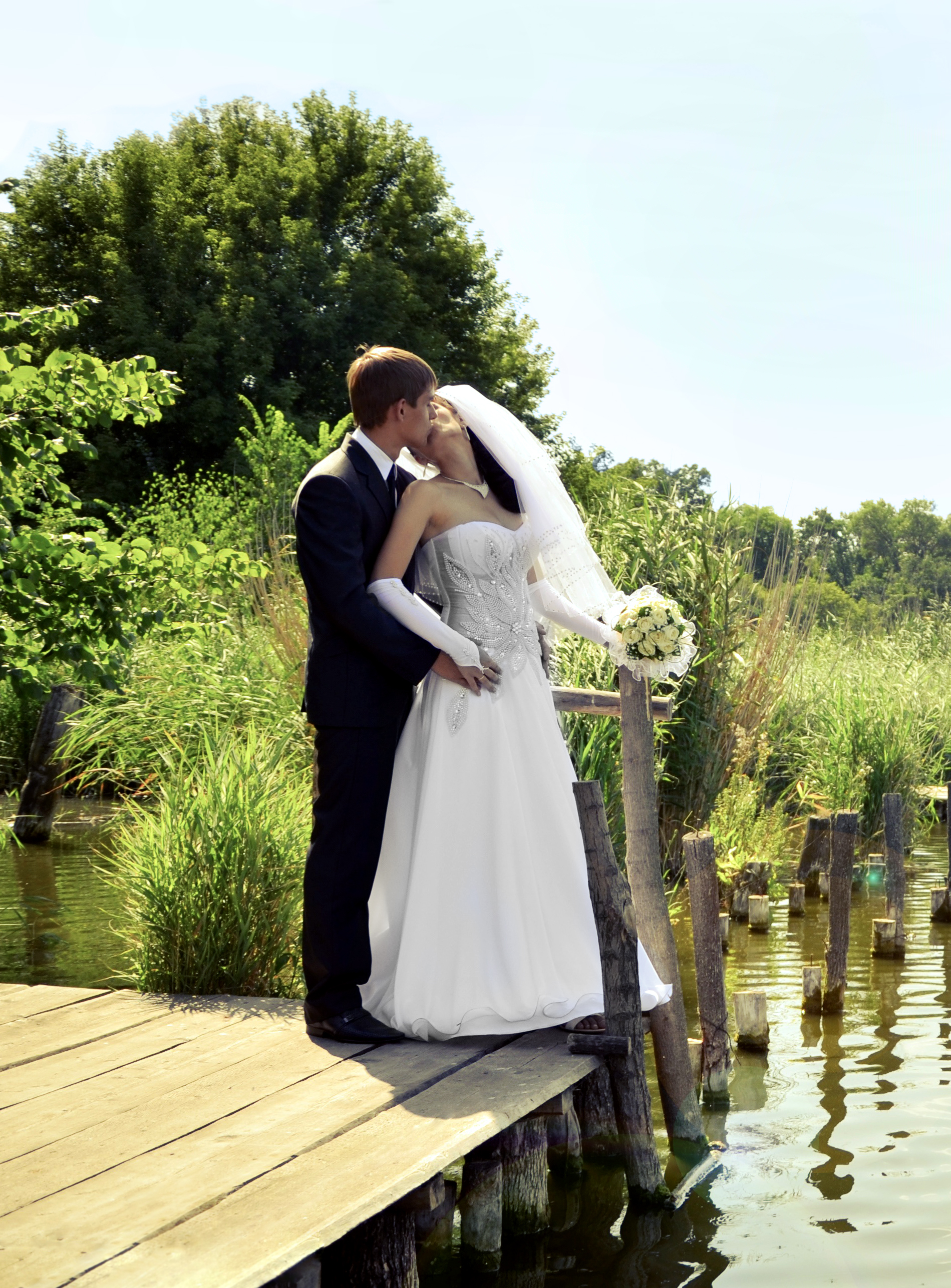 Bride and groom by the river enhanced