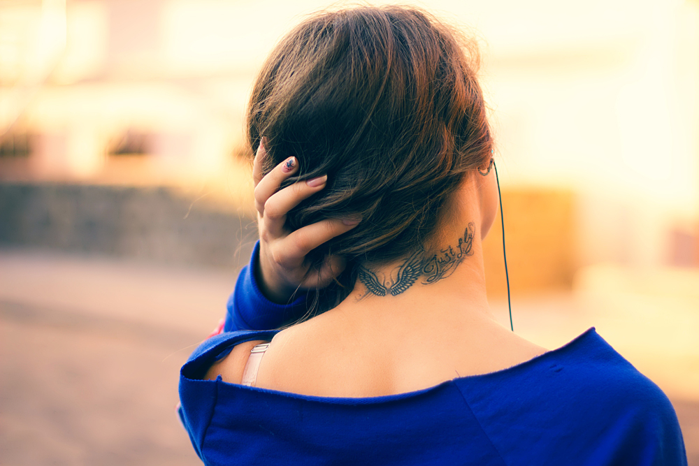 Girl with hairline tattoo.