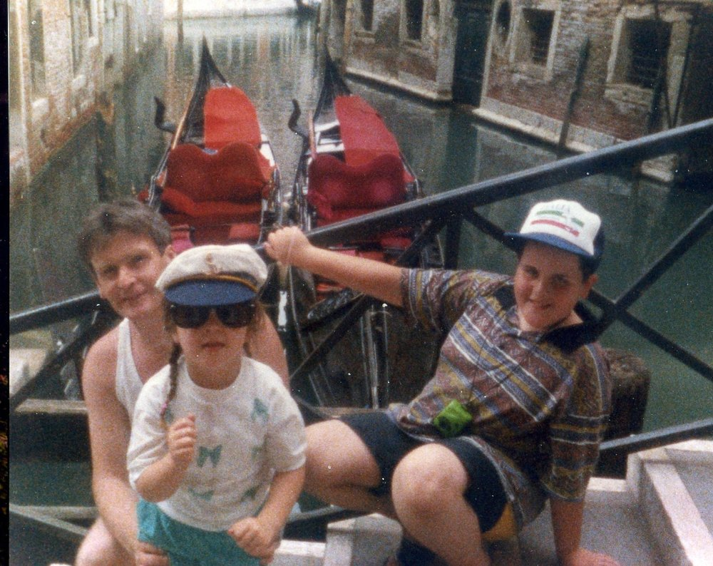 My Dad, Sister, and me with some of Venice's famous gondolas behind.