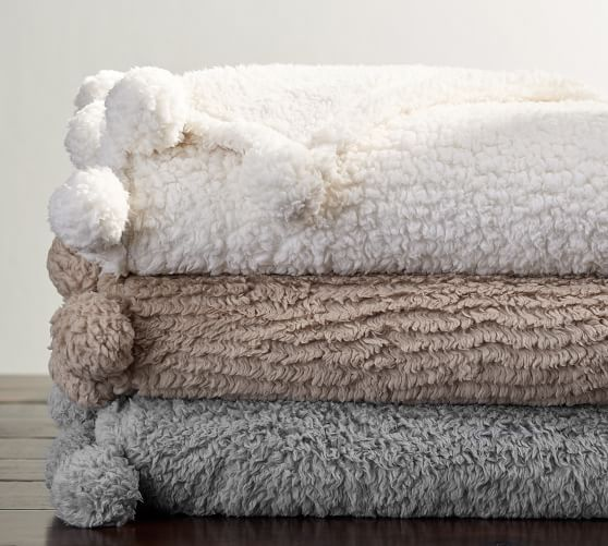 PotteryBarn_cozy-pom-pom-throw-c.jpg