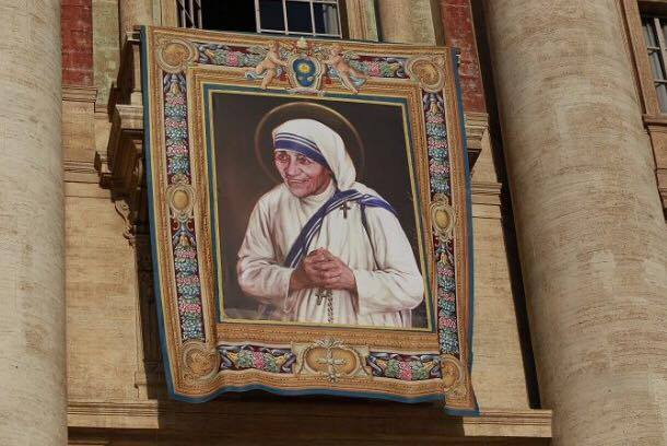 Photo by: Daniel Ibañez/CNA The official banner for Mother Teresa's canonization drapes the facade of St. Peter's Basilica in the Vatican.