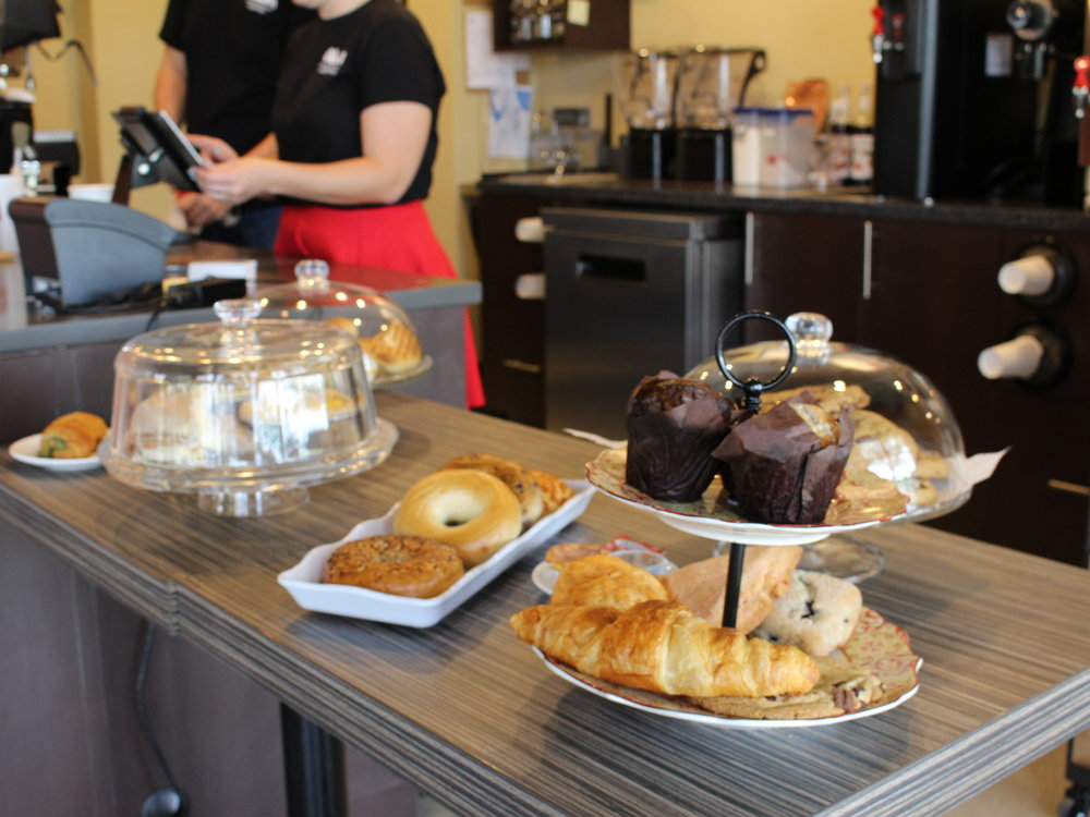 Axum Coffee serves up baked goods to Orlando Cat Cafe's first round of customers. Axum and The Animal League teamed up to help create Orlando Cat Cafe. The cafe's grand opening was held in Clermont Thursday.