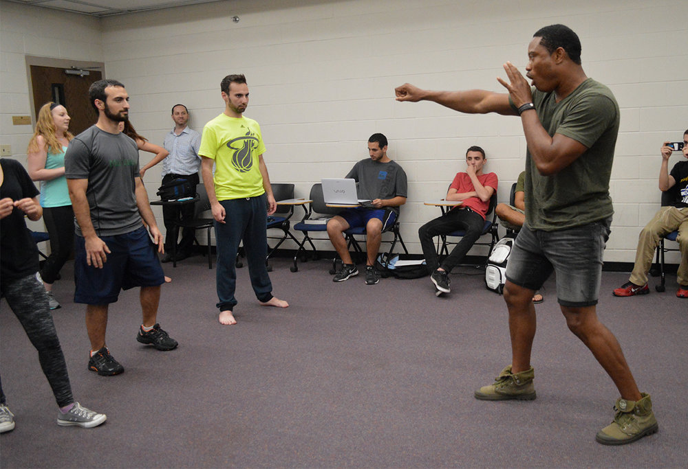 Instructor Pandit Mami, originally from Sierra Leone,demonstrates Israeli self-defense moves during a Knights for Israel meeting in UCF's Engineering I building on Wednesday, Sept. 14, 2016.