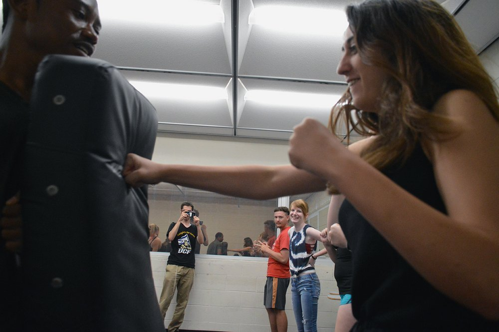 UCF sophomore Rachel Kammerman hits a punching mat during the Krav Maga self-defense lesson in UCF's Engineering I building on Wednesday, Sept. 14, 2016.Krav Maga, an Israeli form of self-defense, is used by the Israel Defense Forces and combines boxing, wrestling and other fight training.