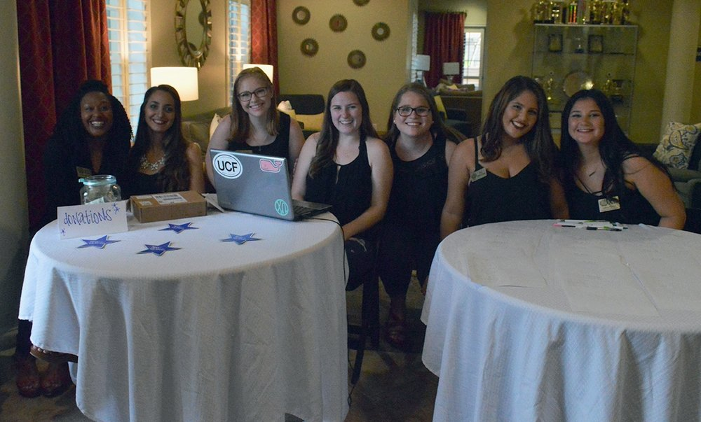 The sisters of Chi Omega at the check in desks for the Scoop-A-Dish for Make-A-Wish event on Thursday, Sept. 15 at the Chi Omega house. Points were awarded at the different events throughout Wish Week and the sorority and fraternity that received the most points gets $250 for the philanthropy of their choice.