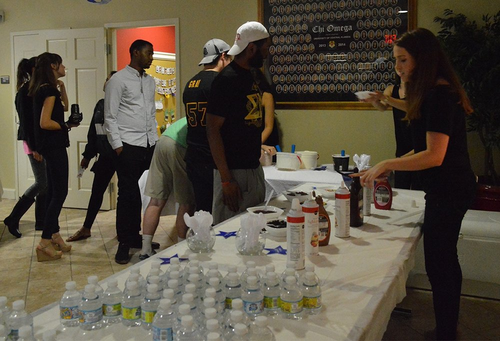 Sigma Nu brother AJ Appiah making the tough decision of what toppings to get on his ice cream at the Scoop-A-Dish for Make-A-Wish event on Thursday, Sept. 15 at the Chi Omega sorority house.