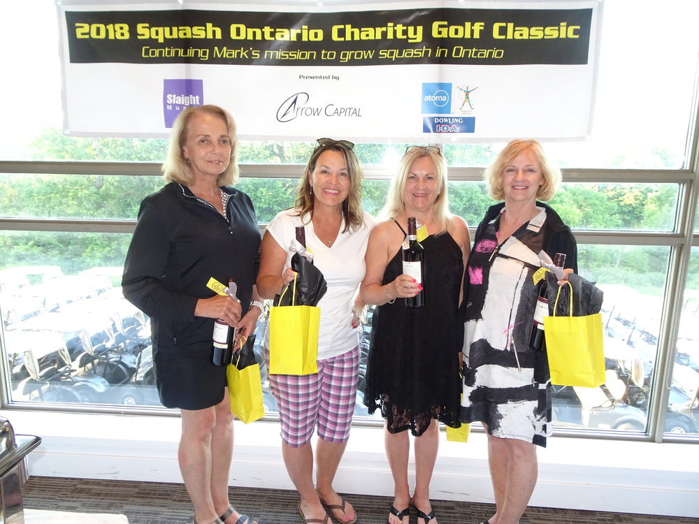 The Women's Division Champions: Barb Finnie, Julie Faaber, Annemarie Sier, and Joanne MacDonald.