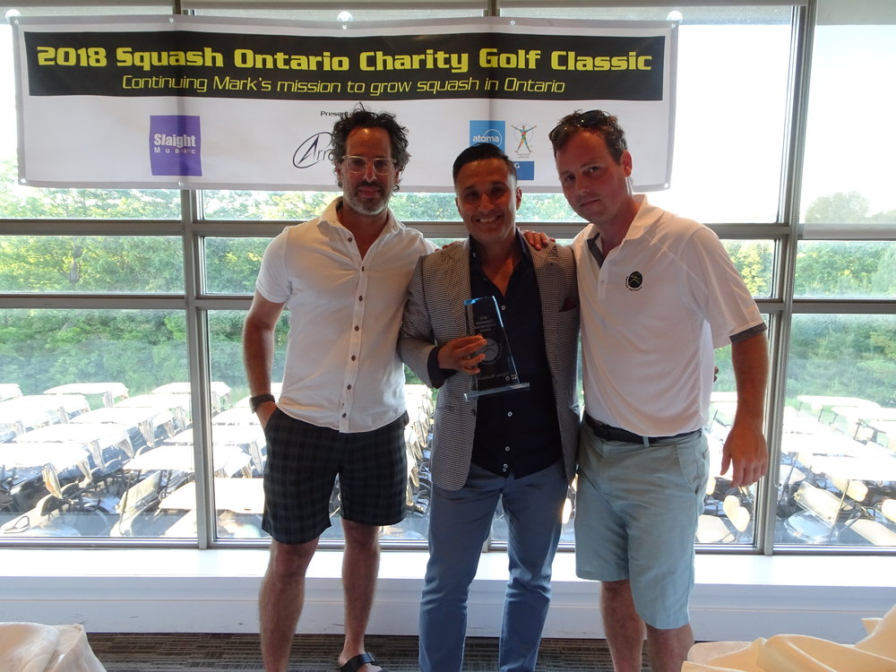 Ash Singh (centre) accepting the award with Simon Kay (left) from the Squash Ontario fundraising committee and Squash Ontario's Executive Director Jamie Nicholls (right)