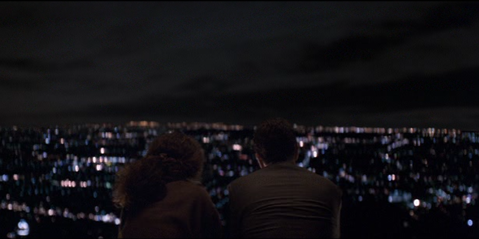 """I'm alone. I'm not lonely,"" says Neil McCauley to Eady (Amy Brenneman), overlooking Los Angeles in  Heat  (Michael Mann, Warner Bros., 1995)"