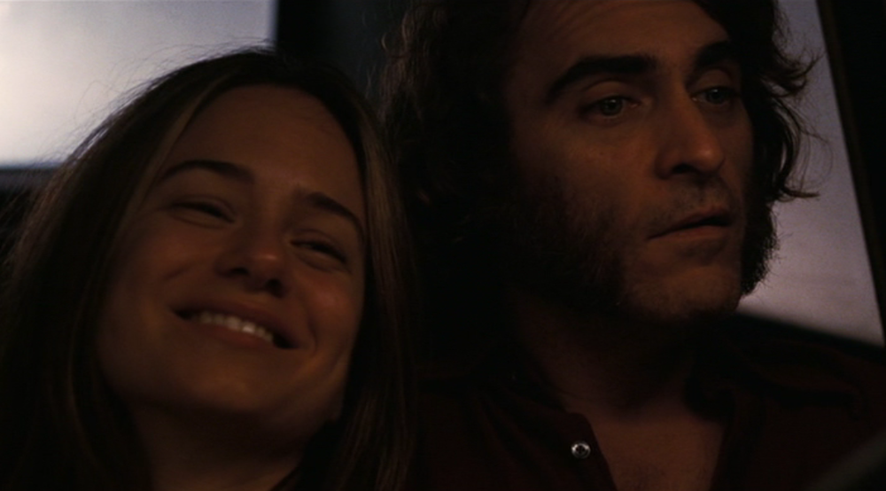 "Shasta Fay Hepworth (Katherine Waterson) and Larry ""Doc"" Sportello (Joaquin Phoenix) in Paul Thomas Anderson's Inherent Vice (Warner Bros., 2014)"