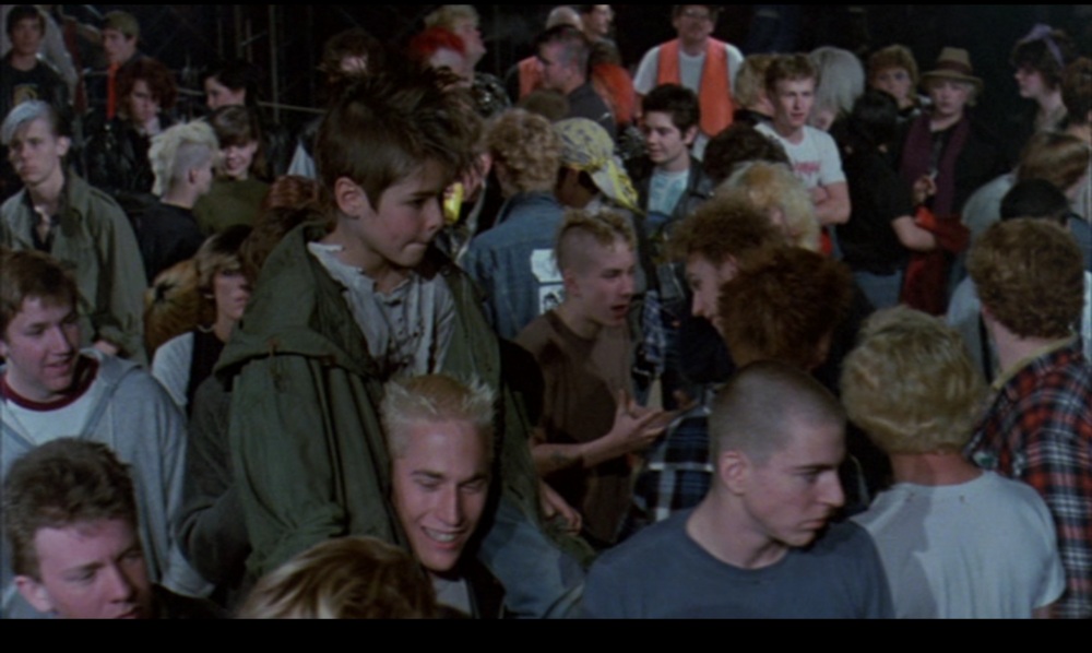 Ethan, now donning a mohawk, at a TSOL gig with his new family in  Suburbia  (Penelope Spheeris, New World Pictures, 1983)