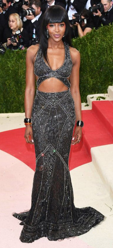elegant-dramatic-style-type-naomicampbell-met-gala-gown-sparkle-sequin-cutout-black-long-hair-bangs-redcarpet.jpg
