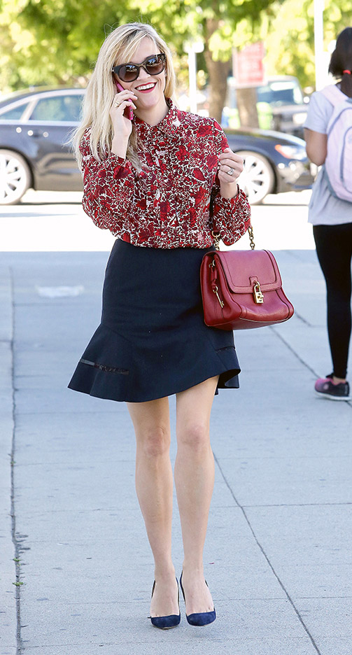 black-mini-skirt-red-top-blouse-print-red-bag-sun-reesewitherspoon-howtowear-style-fall-winter-blonde-work.jpg
